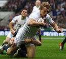 Billy Twelvetrees crashes over to score on his England debut