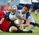 The Waratahs' Israel Folau is felled by the Crusaders' defence