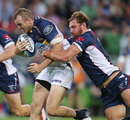 The Brumbies Jesse Mogg is tackled by the Rebels' Scott Higginbotham