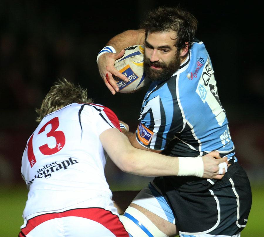 Glasgow's Josh Strauss evades Ulster's Andrew Trimble