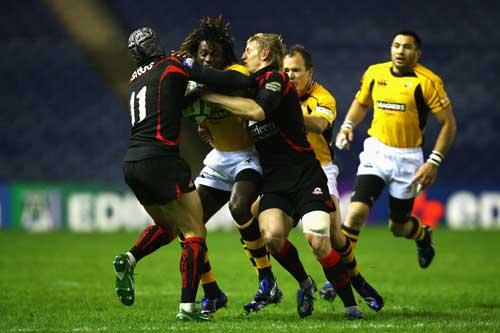 Wasps winger Paul Sackey crashes into the Edinburgh defence