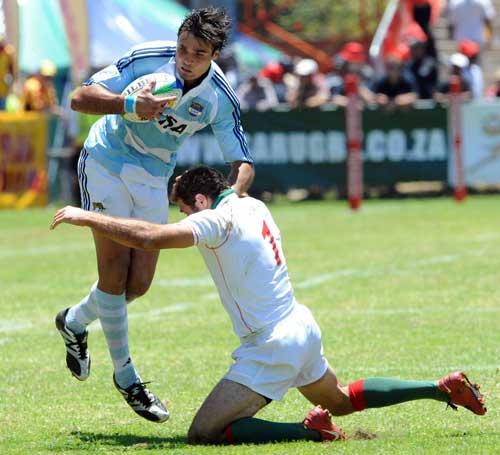 Portugal's Vasco Uva tackles Argentina's Dino Tomas Caceres