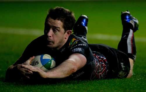 Ospreys winger Shane Williams dives in to score against Treviso