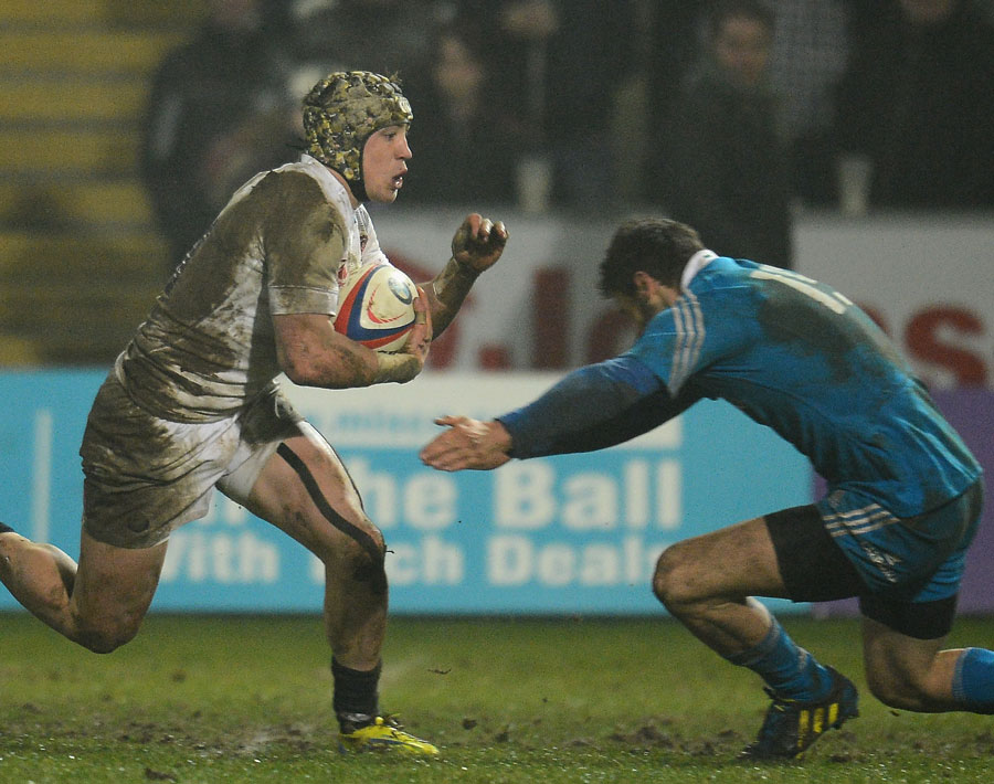 England Under-20's Jack Nowell is confronted by an Italian defender
