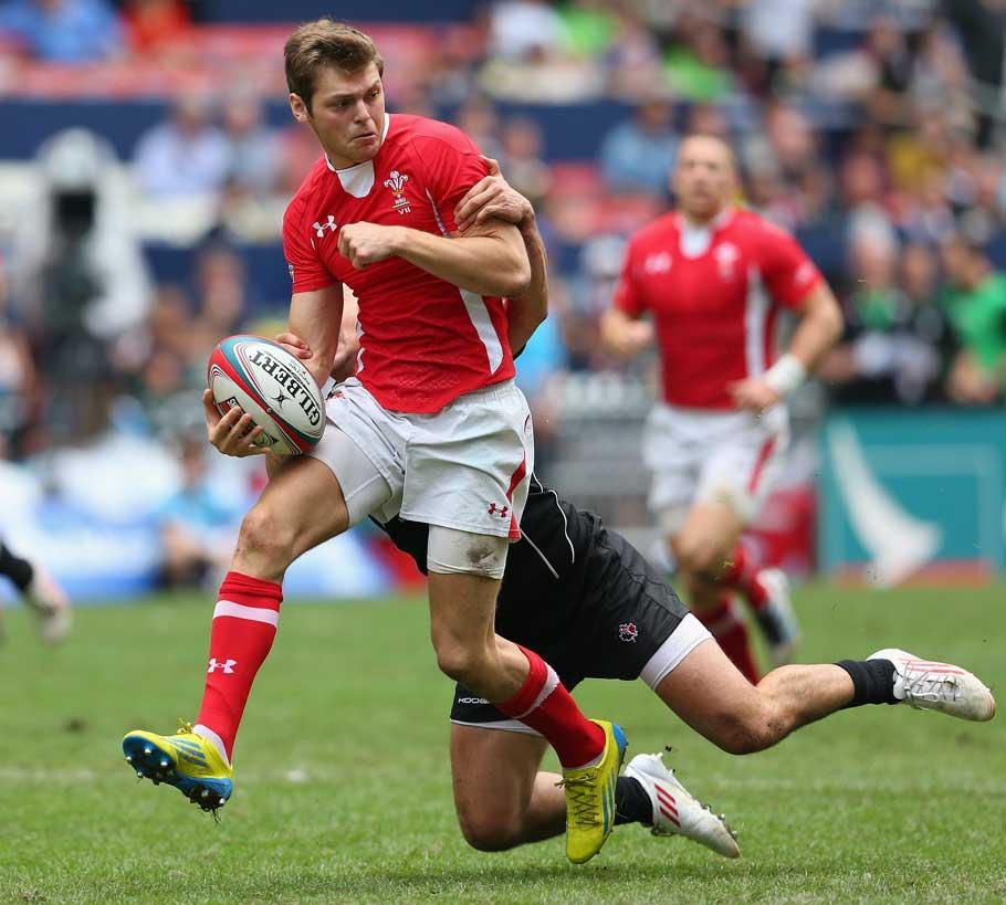 Wales' Alex Webber runs the ball against Canada