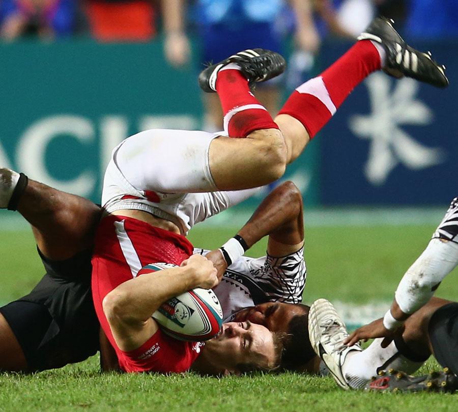 Fiji's Ilai Tinai  tackles Wales' Lee Williams