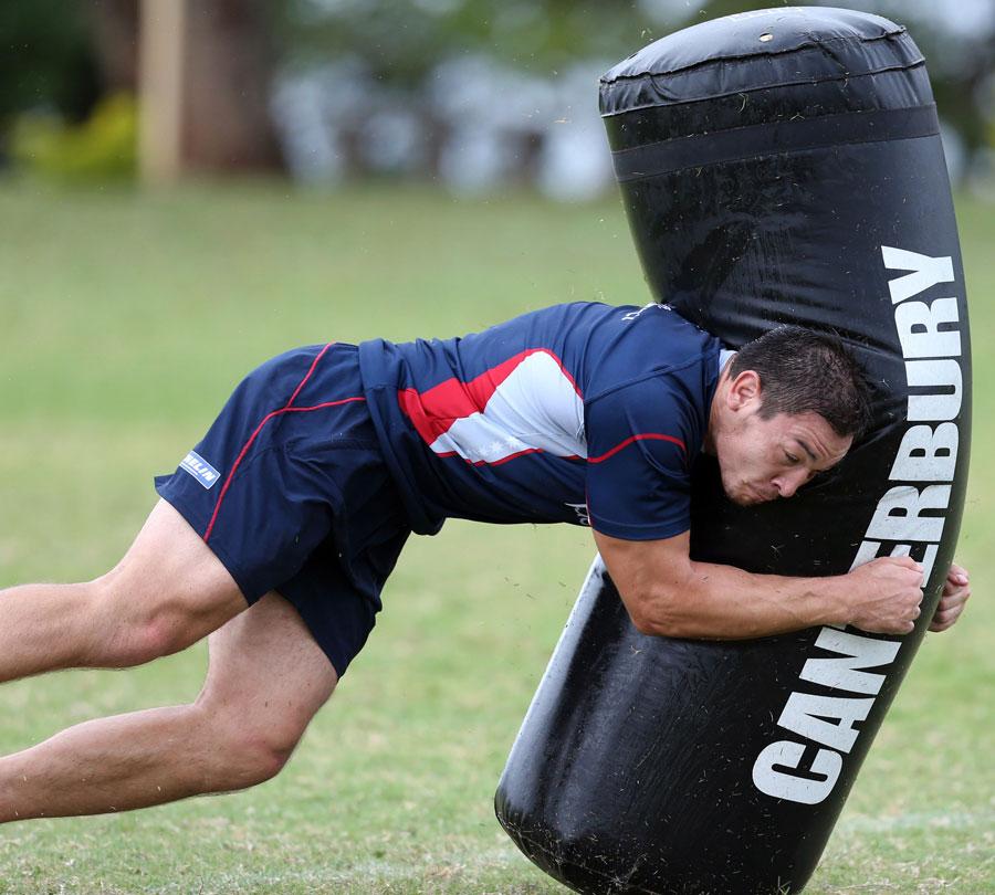 Melbourne Rebels' Gareth Delve hits a tackle bag