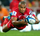 The Reds' Will Genia shifts the ball