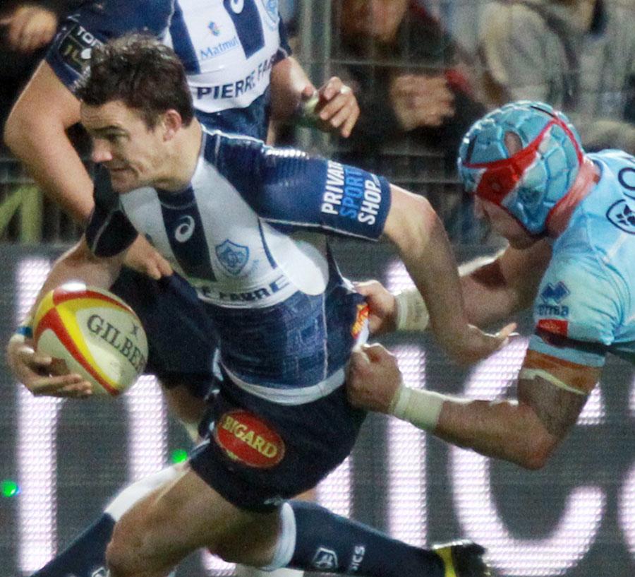 Castres Max Evans tries to evade Perpignan's Alasdair Strokosch