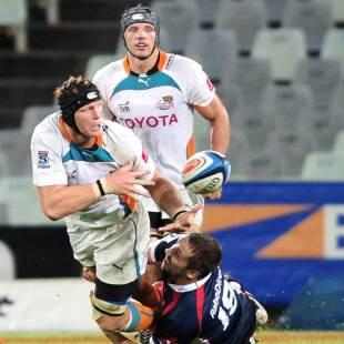 The Cheetahs' Phillip van der Walt offloads, Cheetahs v Melbourne Rebels, Super Rugby, Free State Stadium, Bloemfontein, March 30, 2013
