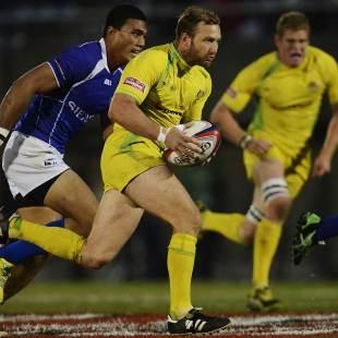 Australia's James Stannard takes on the Samoa defence, Australia v Samoa, Tokyo Sevens, Prince Chichibu Stadium, Tokyo, March 30, 2013