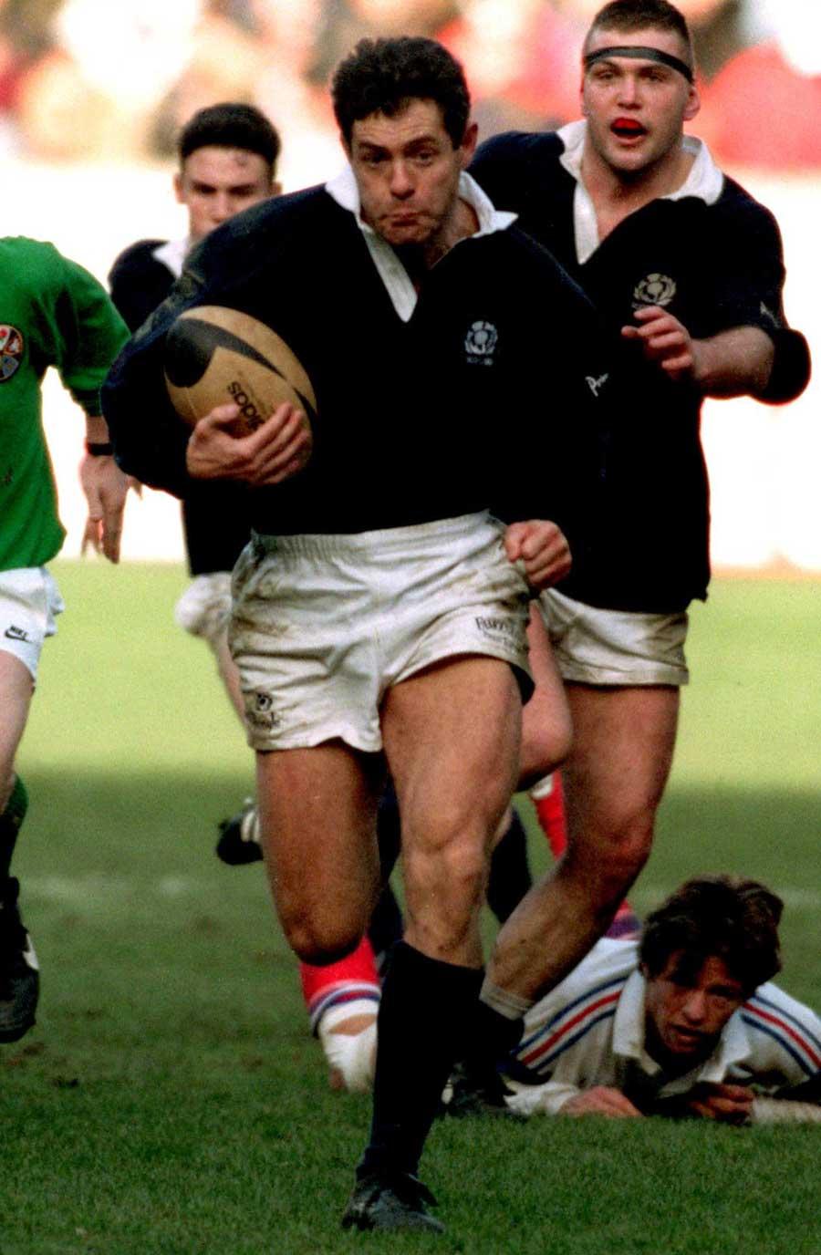 Scotland's Gavin Hastings breaks away against France
