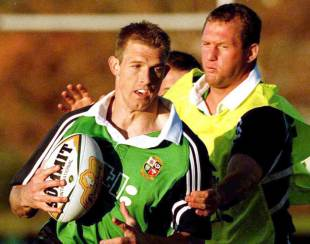 Richard Hill tries to take down Dafydd James, Palmyra Rugby Club, Perth, June 4, 2001