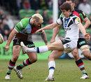 Bath's Ollie Devoto clears before Harlequins' Joe Marler can tackle him