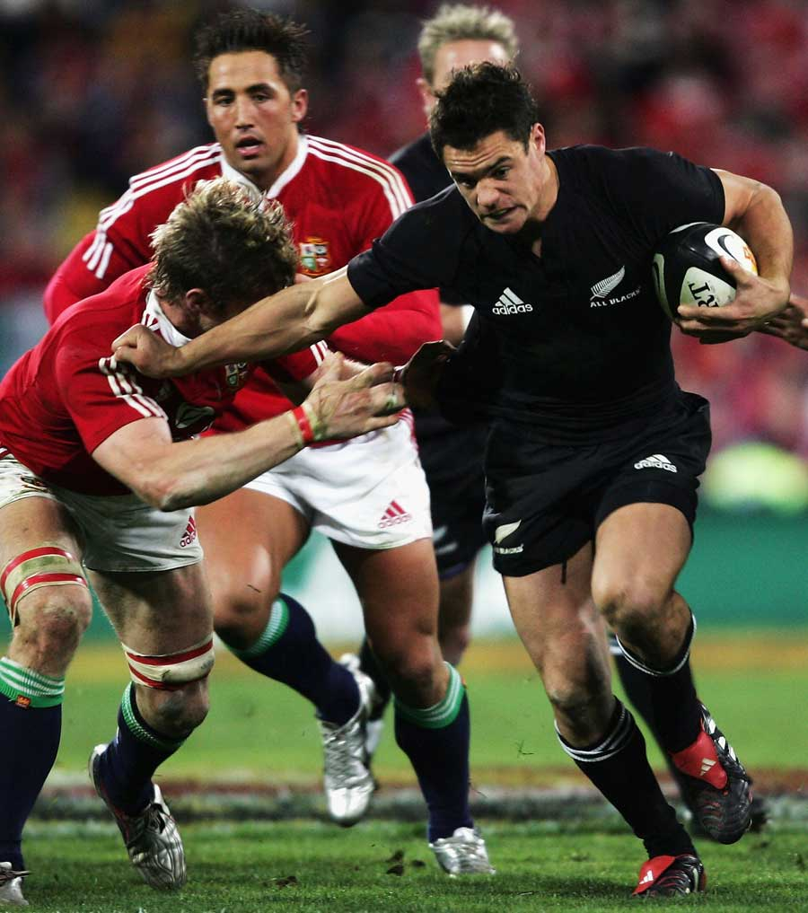 Dan Carter waltzes past Simon Easterby. New Zealand v British and Irish Lions, Second Test, Westpac Stadium, July 2 2005.