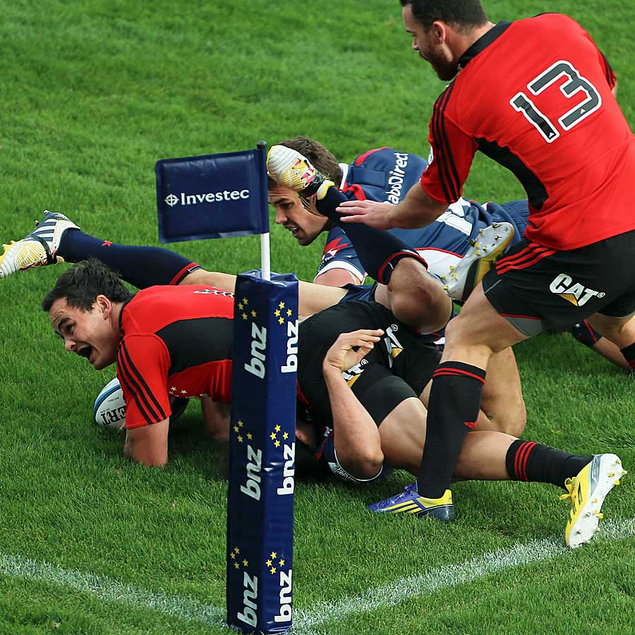 The Crusaders' Zac Guildford scores a try against the Rebels