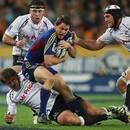 The Highlanders' Ben Smith resists the Sharks