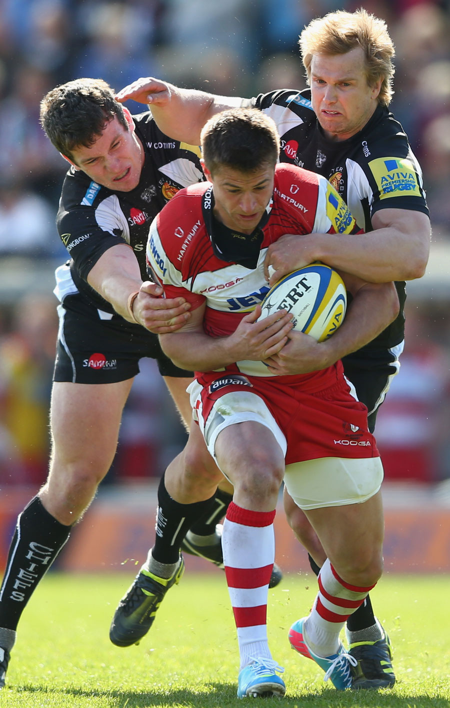 Gloucester's Henry Trinder is shackled by the Exeter defence