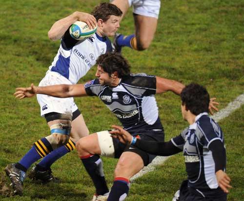 Leinster's centre Brian O'Driscoll beats Castres' scrum-half Sebastien Tillous-Borde