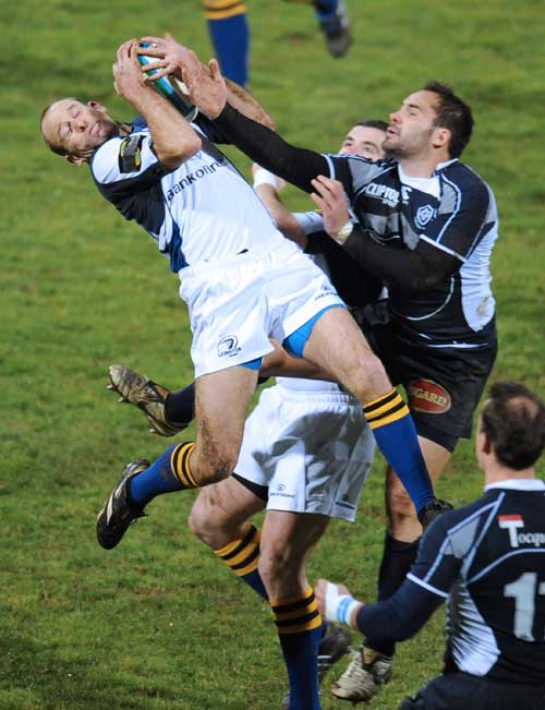 Leinster's fullback Chris Whitaker (L) vies with Castres' No.8 Florian Faure