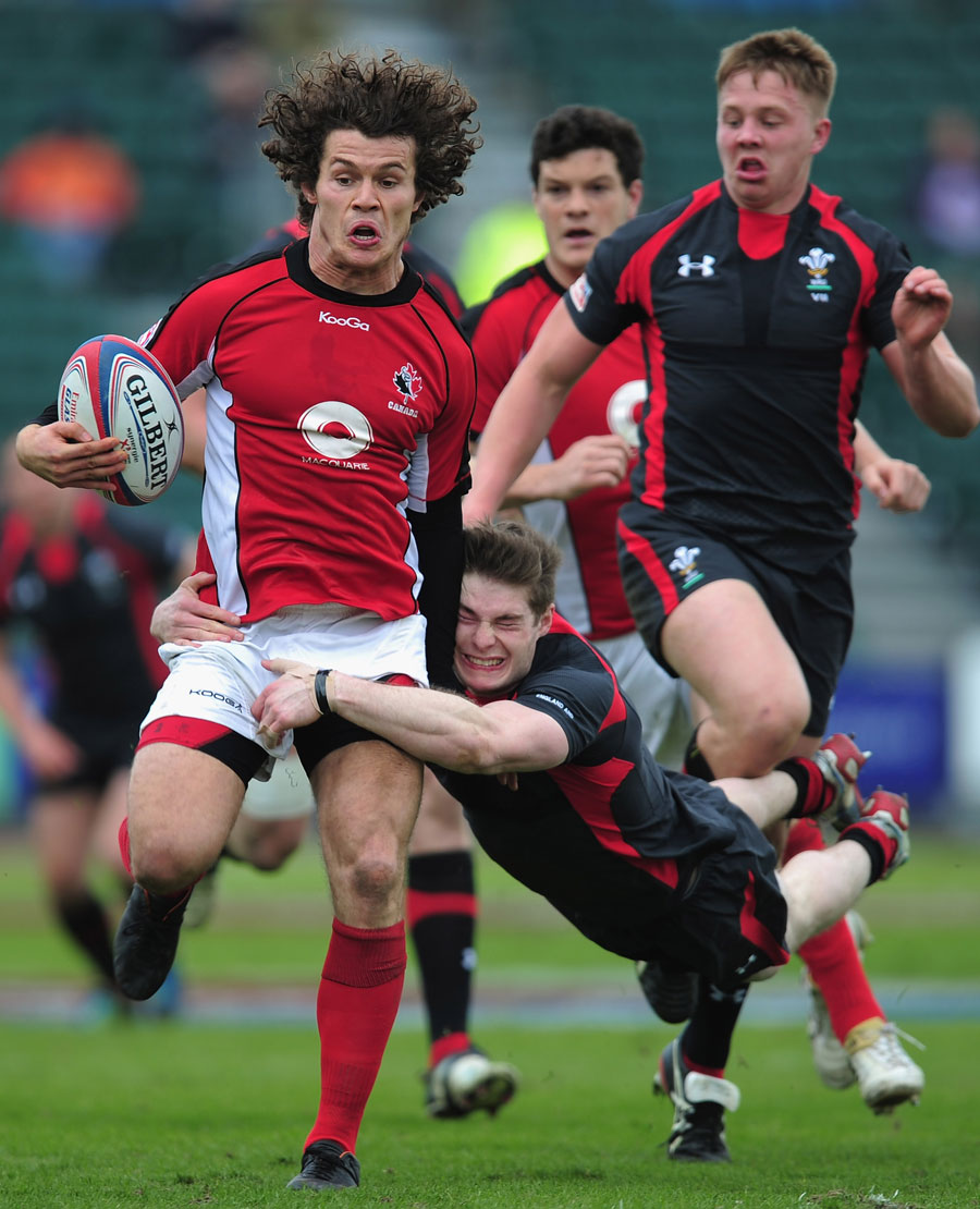 Wales' James Davies hauls down Canada's Taylor Paris