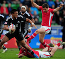 New Zealand's Lote Raikabula slips the tackle of Wales' Tom Graham