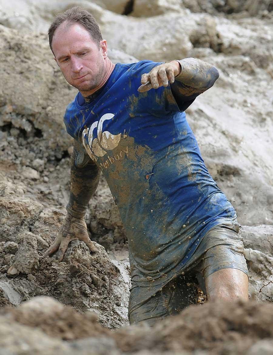 Mike Catt wades through the mud at Tough Mudder 2013