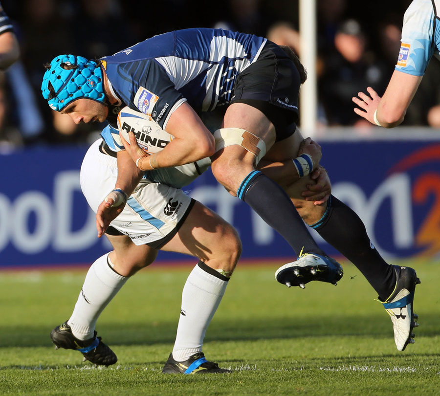 Leinster's Kevin McLaughlin is tackled by Glasgow Warriors' Ryan Grant