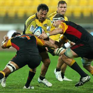 Ash Dixon of the Hurricanes is tackled, Hurricanes v Chiefs, Super Rugby, Westpac Stadium, Wellington, May 17, 2013