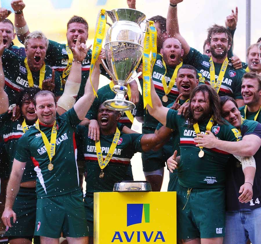 Leicester's Geordan Murphy and Martin Castrogiovanni hold aloft the Aviva Premiership trophy
