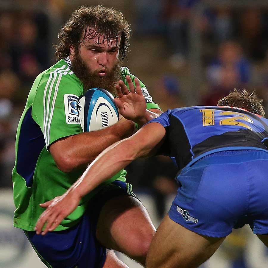 Liam Coltman of the Highlanders tries to fend off a tackle