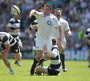 England's David Wilson off loads the ball