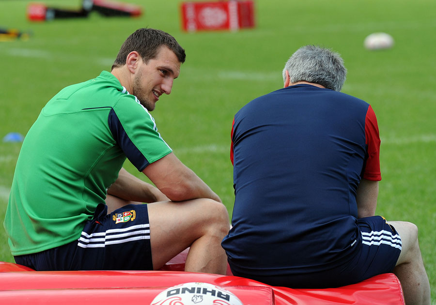 Lions captain Sam Warburton chats with tour manager Andy Irvine during the first Lions training session