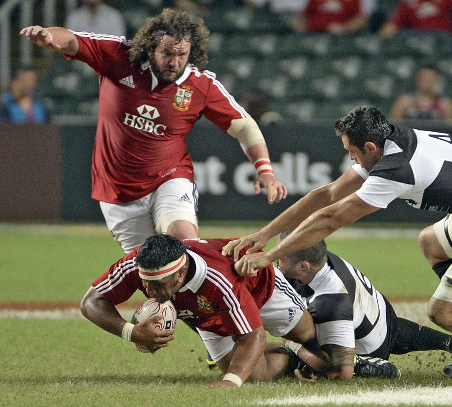 The Lions' Mako Vunipola earns some hard yards