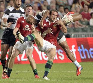 The Lions' Jamie Roberts looks to secure the ball, British & Irish Lions v Barbarians, Hong Kong Stadium, Hong Kong, June 1, 2013