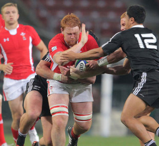 Wales' Dan Baker tries to break through the New Zealand defence. New Zealand v Wales, IRB U20 World Championship, Newlands Stadium, Cape Town, South Africa, June 17, 2012