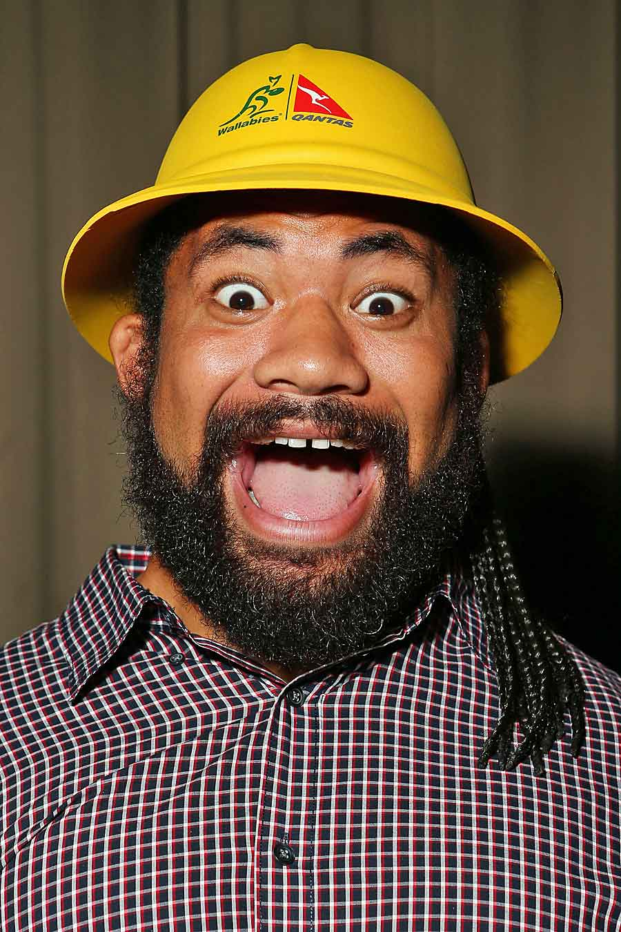 Tatafu Polota-Nau models one of the golden safari hats to be given away to Wallabies fans in order to combat the 'sea of red'