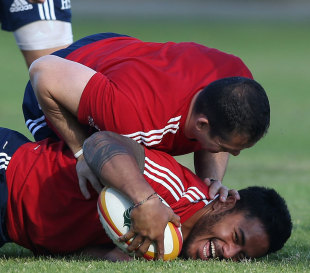 Who's boss? Manu Tuilagi is pinned down by defence coach Andy Farrell  during a  Lions training session, Langley Park, Perth, June 3, 2013