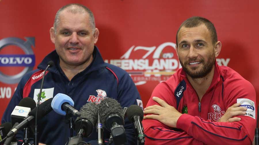 Reds coach Ewen McKenzie sits alongside Quade Cooper