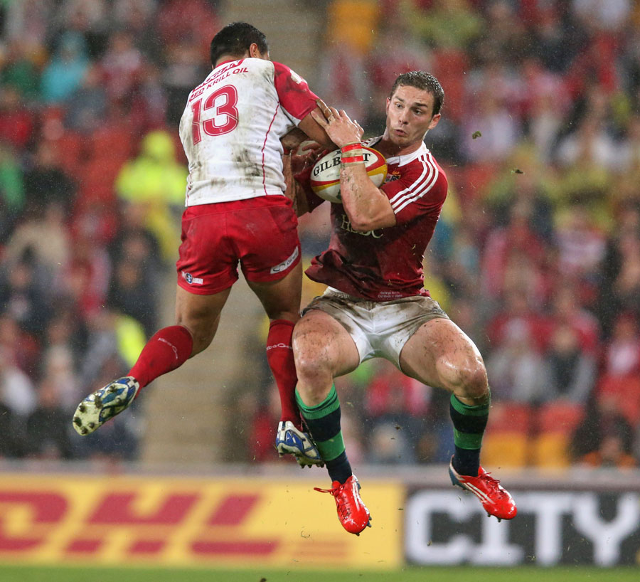 The Lions' George North and the Reds' Ben Tapuai vie for the ball