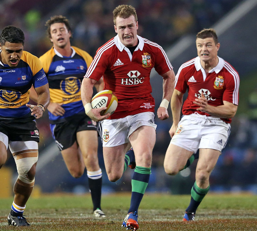Lions fly-half Stuart Hogg carves his way through the Combined Country defence