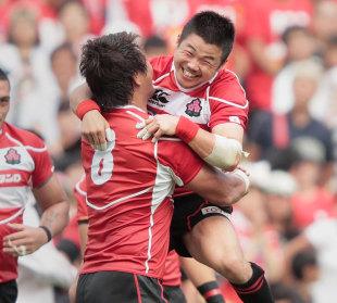 Japan's Fumiaki Tanaka and Takashi Kikutani celebrate victory over Wales, Japan v Wales, Prince Chichibu Stadium, Tokyo, June 15, 2013