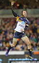 The Brumbies' Jesse Mogg celebrates his side's victory over the Lions