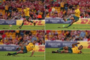 Australia's Kurtley Beale slips as he attempts to kick a penalty, Australia v British & Irish Lions, Suncorp Stadium, Brisbane, June 22, 2013