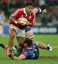 The Lions' Manu Tuilagi charges upfield against the Rebels