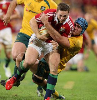 Australia's James Horwill tackles the Lions' George North, Australia v British & Irish Lions, Suncorp Stadium, Brisbane, June 22, 2013
