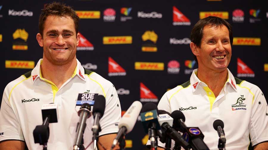 Australian skipper James Horwill sits alongside Robbie Deans