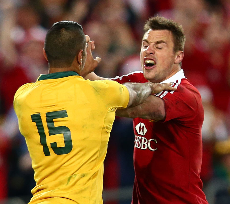 The Lions' Tommy Bowe faces up to Australia's Kurtley Beale