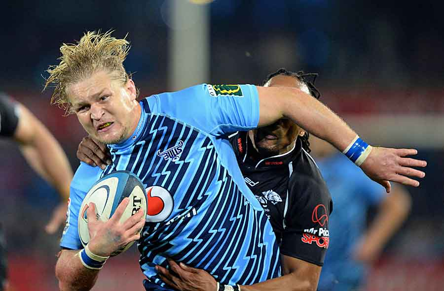 The Sharks' Odwa Ndungane tackles the Bulls' Dewald Potgieter