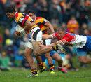 Waikato's Dylan Collier evades Horowhenua-Kapiti's Darryl Saunders-May